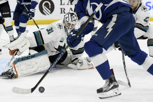 San Jose Sharks goaltender Martin Jones (31) keeps his eyes on the puck during the second period of an NHL hockey game against the Tampa Bay Lightning, Saturday, Jan. 19, 2019, in Tampa, Fla. (AP Photo/Jason Behnken)