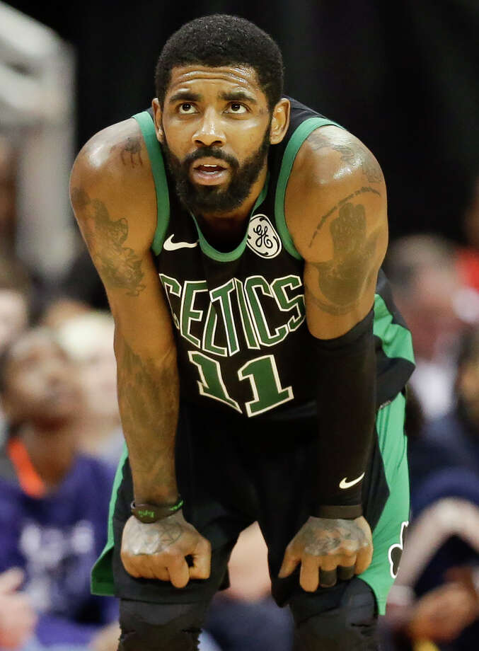 Boston Celtics guard Kyrie Irving looks at the scoreboard late in the second half of an NBA basketball game against the Houston Rockets, Thursday, Dec. 27, 2018, in Houston. (AP Photo/Eric Christian Smith) Photo: Eric Christian Smith / Copyright 2018 The Associated Press. All rights reserved.