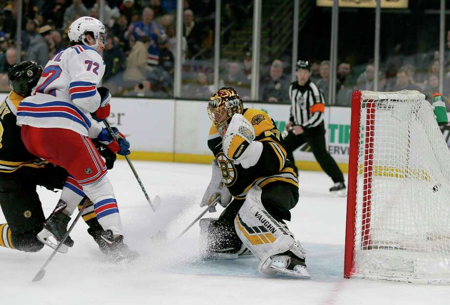 New York Rangers center Filip Chytil (72) scores a goal before colliding with Boston Bruins goaltender Tuukka Rask (40) during the first period of an NHL hockey game, Saturday, Jan. 19, 2019, in Boston. (AP Photo/Mary Schwalm) Photo: Mary Schwalm / Copyright 2019 The Associated Press. All rights reserved.