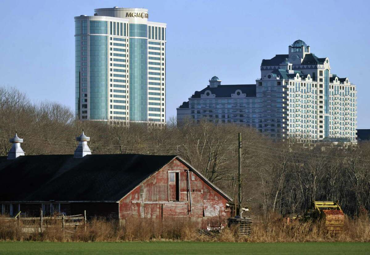 In this Nov. 11, 2012 file photo, Foxwoods Resorts Casino and MGM Grand at Foxwoods buildings loom behind a barn in Mashantucket, Conn.