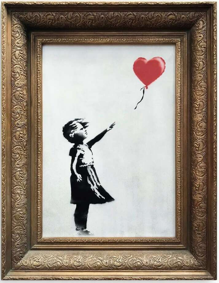 A Connecticut artist recreated this well-known Banksy painting at Women's March in New York City on Jan. 19, 2019. Photo: Contributed Photo / Contributed Photo / Connecticut Post Contributed