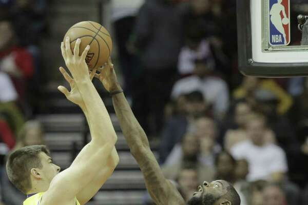 Rockets forward James Ennis III, right, blocks a shot attempt by Lakers center Ivica Zubac at Toyota Center on Saturday. It was one of four Rockets' blocks for the game.