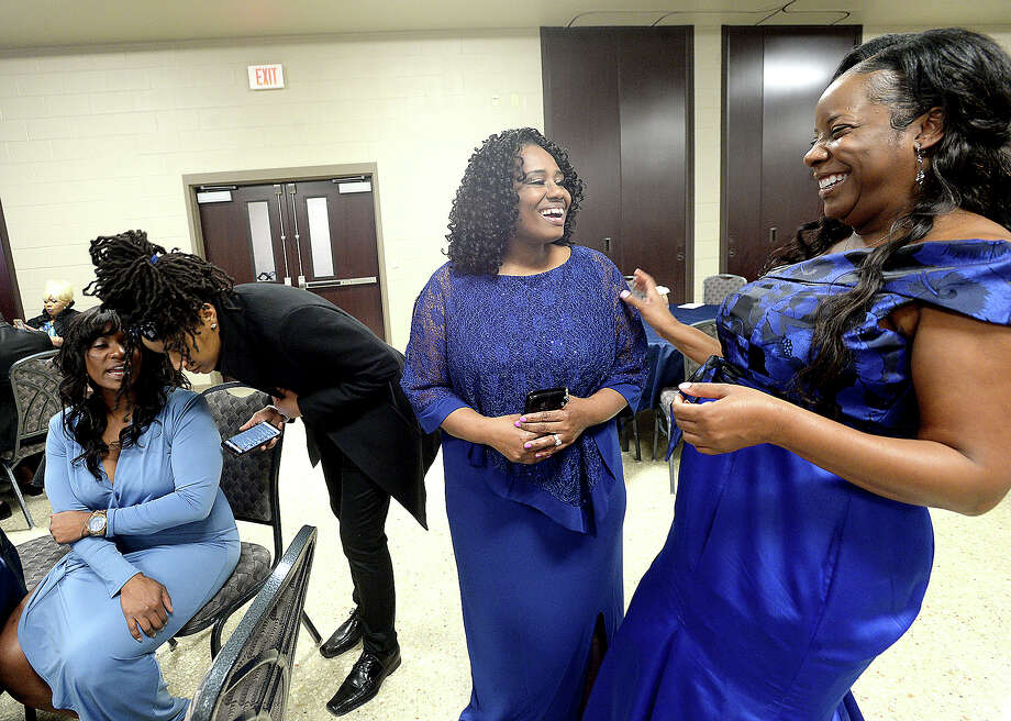"From right, Robbie Daughtery, Jan Cooper, LaBarbara Locks and J. Gray socialize as they gather during the 2019 Blossoming Minds MLK Gala honoring the enduring legacy of Dr. Martin Luther King, Jr., Saturday at the Orange Convention & Expo Center. In the spirit of the theme ""Shades of Blue,"" as blue is a color of royalty, attendees dressed accordingly. Photo taken Saturday, January 19, 2019 Photo by Kim Brent/The Enterprise Photo: Kim Brent/The Enterprise"