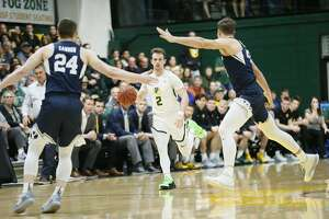 San Francisco Dons guard Frankie Ferrari (2) dribbles against the Brigham Young Cougars in the first half of an NCAA basketball game at the War Memorial Gymnasium on Saturday, Jan. 19, 2019, in San Francisco, Calif.