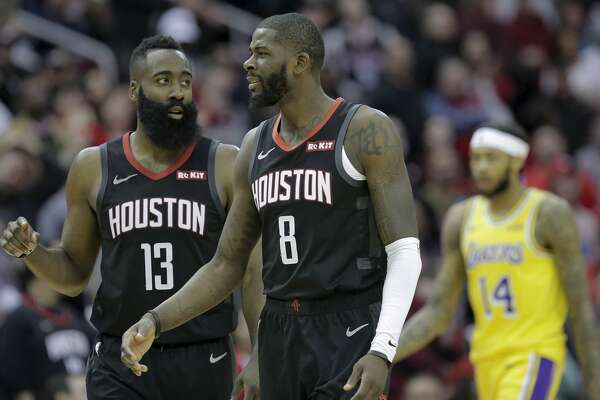 Houston Rockets guard James Harden (13) talks with Houston Rockets forward James Ennis III (8) during a time out against the Los Angeles Lakers at the Toyota Center on Saturday, Jan. 19, 2019 in Houston. Rockets won the game in overtime 138-134.