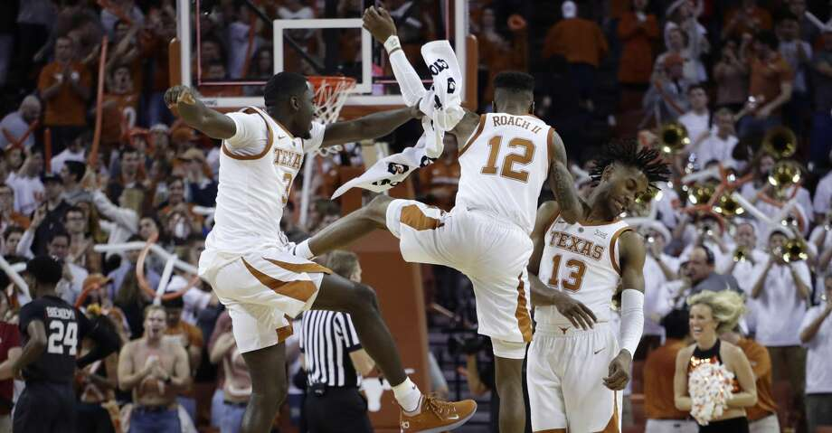 Texas guard Courtney Ramey (3), guard Kerwin Roach II (12) and guard Jase Febres (13) celebrate their win over Oklahoma in an NCAA college basketball game in Austin, Texas, Saturday, Jan. 19, 2019. Texas won 75-72. (AP Photo/Eric Gay) Photo: Eric Gay/Associated Press
