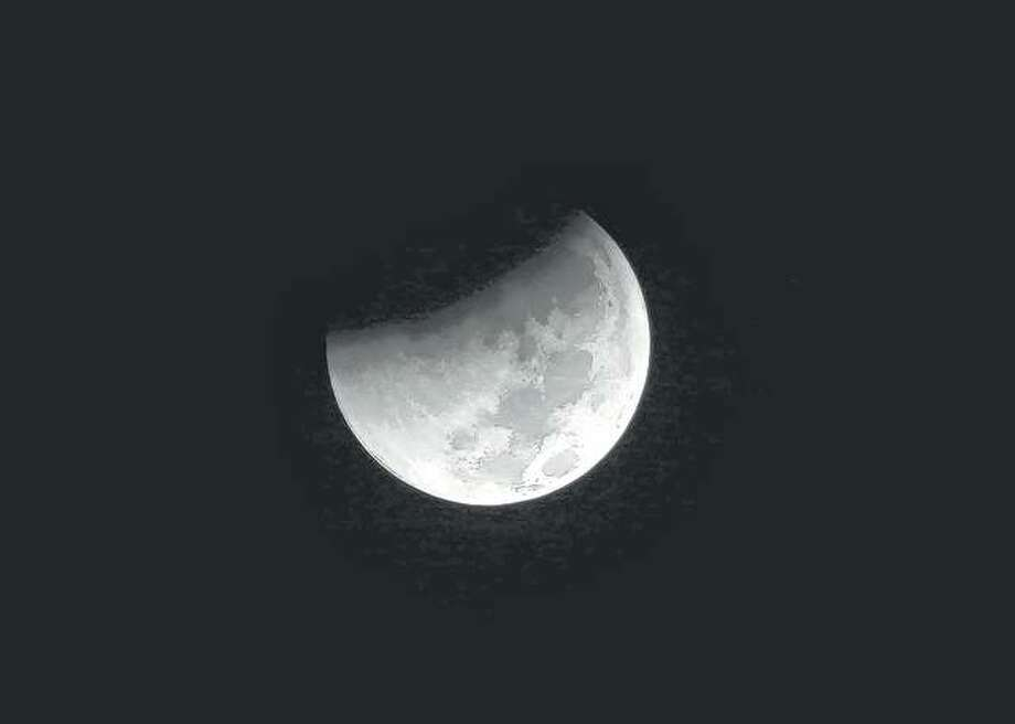 The Earth starts to cast its shadow on the moon during a complete lunar eclipse last year. Starting tonight, all of North America and South America will be able to see the only total lunar eclipse of 2019 from start to finish. Photo: Tatan Syuflana | AP
