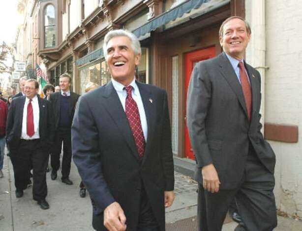 Senate Majority Leader Joseph Bruno shares a laugh with Gov. George?Pataki during a walk along Second Street on Dec. 4, 2001 in Troy.  The walking tour ended at Proctor's Theater. (Times Union file photo)