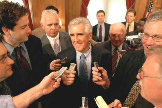Senate Majority Leader Joseph Bruno, center, fields questions from the media following his press conference on restructuring racing and gaming in New York on Oct. 16, 2007, at the state Capitol in Albany. (Times Union file photo)
