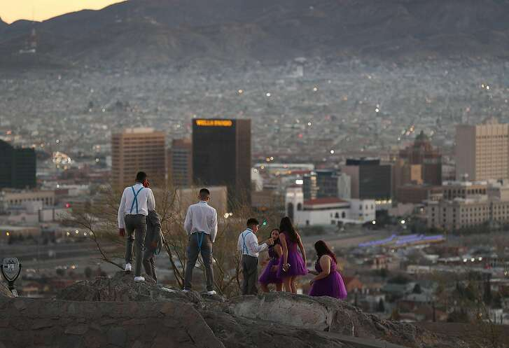 EL PASO, TEXAS - JANUARY 19:    People visit an overview of the skyline of El Paso and Ciudad Juarez, Mexico  on January 19, 2019 in El Paso, Texas. The U.S. government is partially shutdown as President Donald Trump is asking for $5.7 billion to build additional walls along the U.S.-Mexico border and the Democrats oppose the idea. (Photo by Joe Raedle/Getty Images)