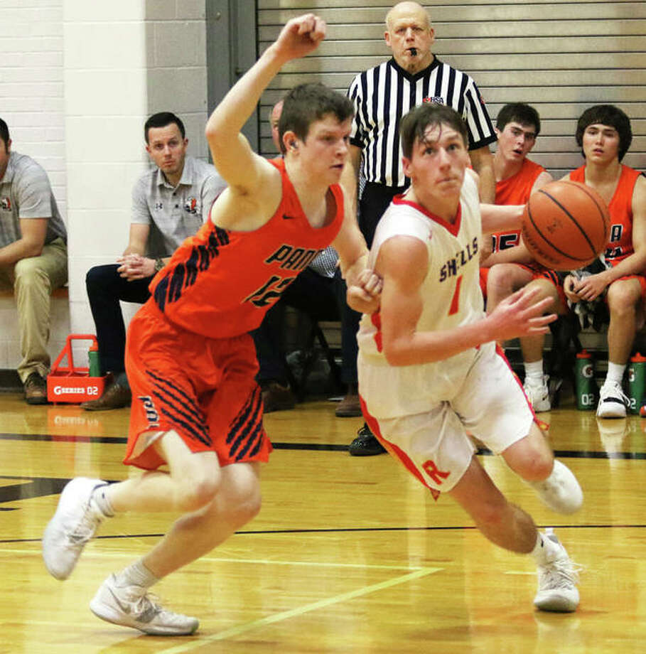 Roxana's Andrew Beckman (right) drives past Pana's Wesley Kile during the Shells' pool play game earler this week at Panther Gym in Litchfield. On Saturday, Beckman hit seven 3-pointers and scored 26 points in Roxana's fifth-place victory over Metro-East Lutheran. Photo: Greg Shashack / The Telegraph