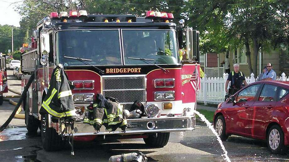 File photo of a Bridgeport fire truck after a fire on Horace Street on Aug. 9, 2018 Photo: Contributed Photo / Bridgeport Fire Department / Contributed Photo / Connecticut Post Contributed