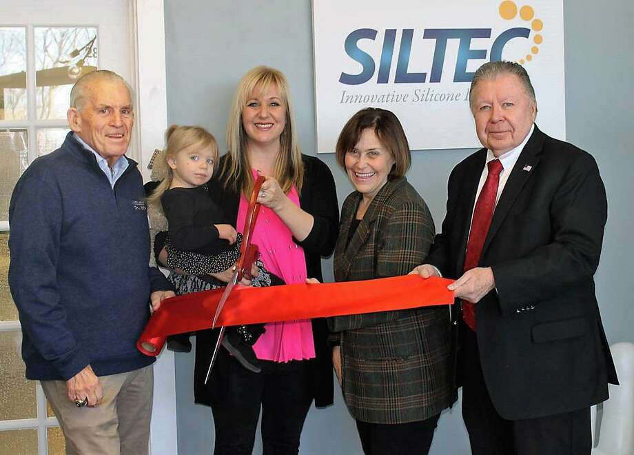 SilTec Labs, innovative silicone specialists, had a grand opening in Portland Friday. From left are Middlesex County Chamber of Commerce President Larry McHugh, Dallas Radziwon, Owner Leigh Radziwon, Portland First Selectwoman Susan Bransfield and Chamber Chairman Jay Polke. Photo: Contributed Photo