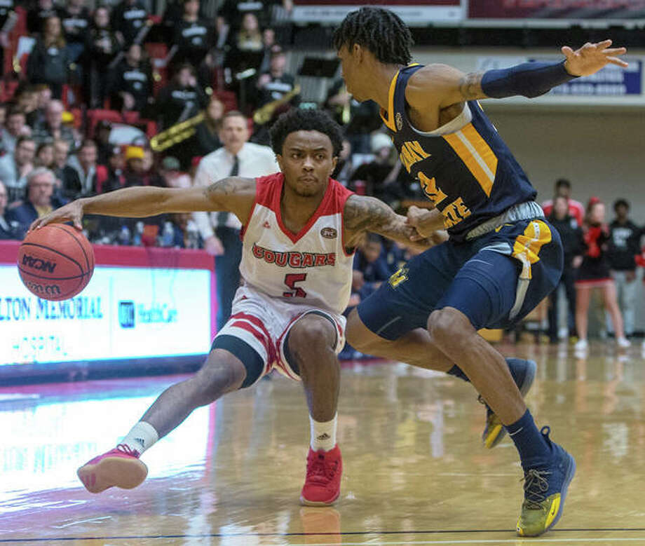 SIUE's Tyresse Williford (left) handles the ball against pressure from Murray State on Saturday night at the Vadalabene Center in Edwardsville. Williford scored a career-high 33 points in the Cougars' OVC loss. Photo: SIUE Athletics