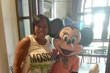 Keisha L. Williams, 43, of Ashburn, Va. posing on a 2016 trip to Disney World she paid for through a scam health-care business.