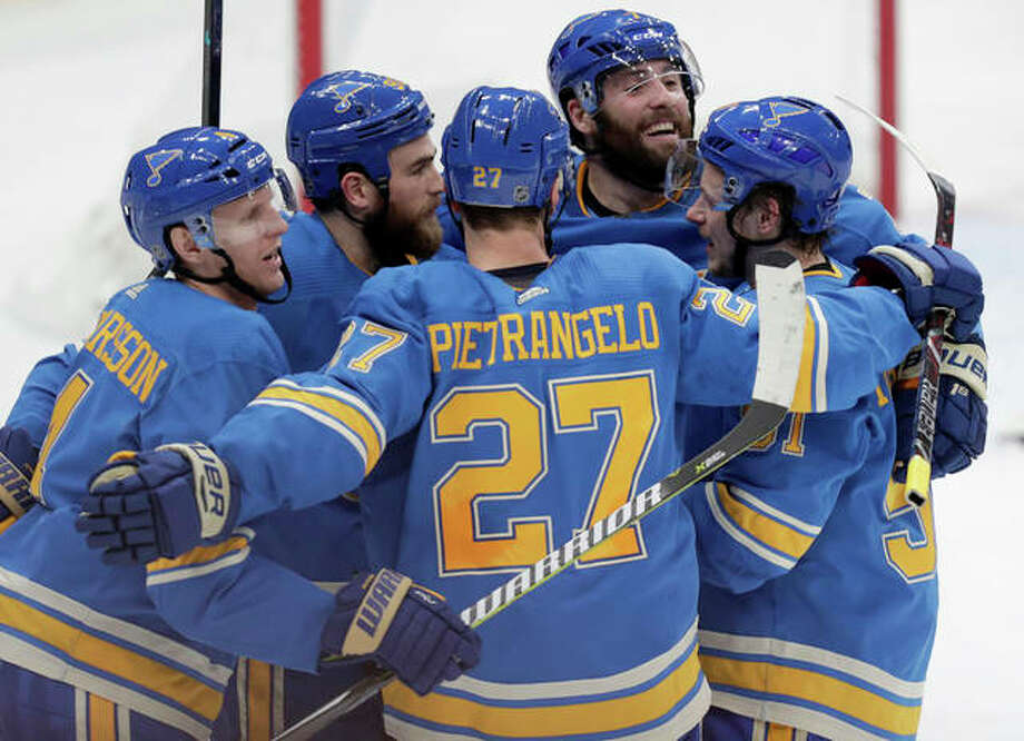 The Blues' Carl Gunnarsson (left) celebrates with teammates Alex Pietrangelo (27), Vladimir Tarasenko (91), Pat Maroon (7) and Ryan O'Reilly after he scored in the third period of Saturday night in a win over the Ottawa Senators in St. Louis. Photo: Associated Press