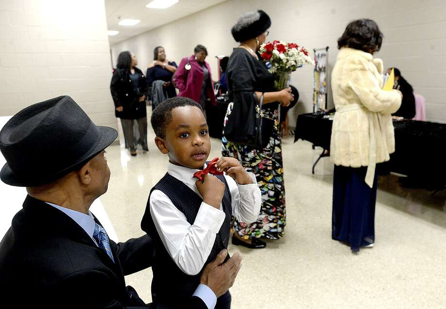 Josiah Colbert adjusts his bow tie as he sits with his grandfather Herman Richard and takes in the arrival of guests at the 2019 Blossoming Minds MLK Gala honoring the enduring legacy of Dr. Martin Luther King, Jr., Saturday at the Orange Convention & Expo Center.  Photo taken Saturday, January 19, 2019 Photo by Kim Brent/The Enterprise Photo: Kim Brent / The Enterprise / BEN
