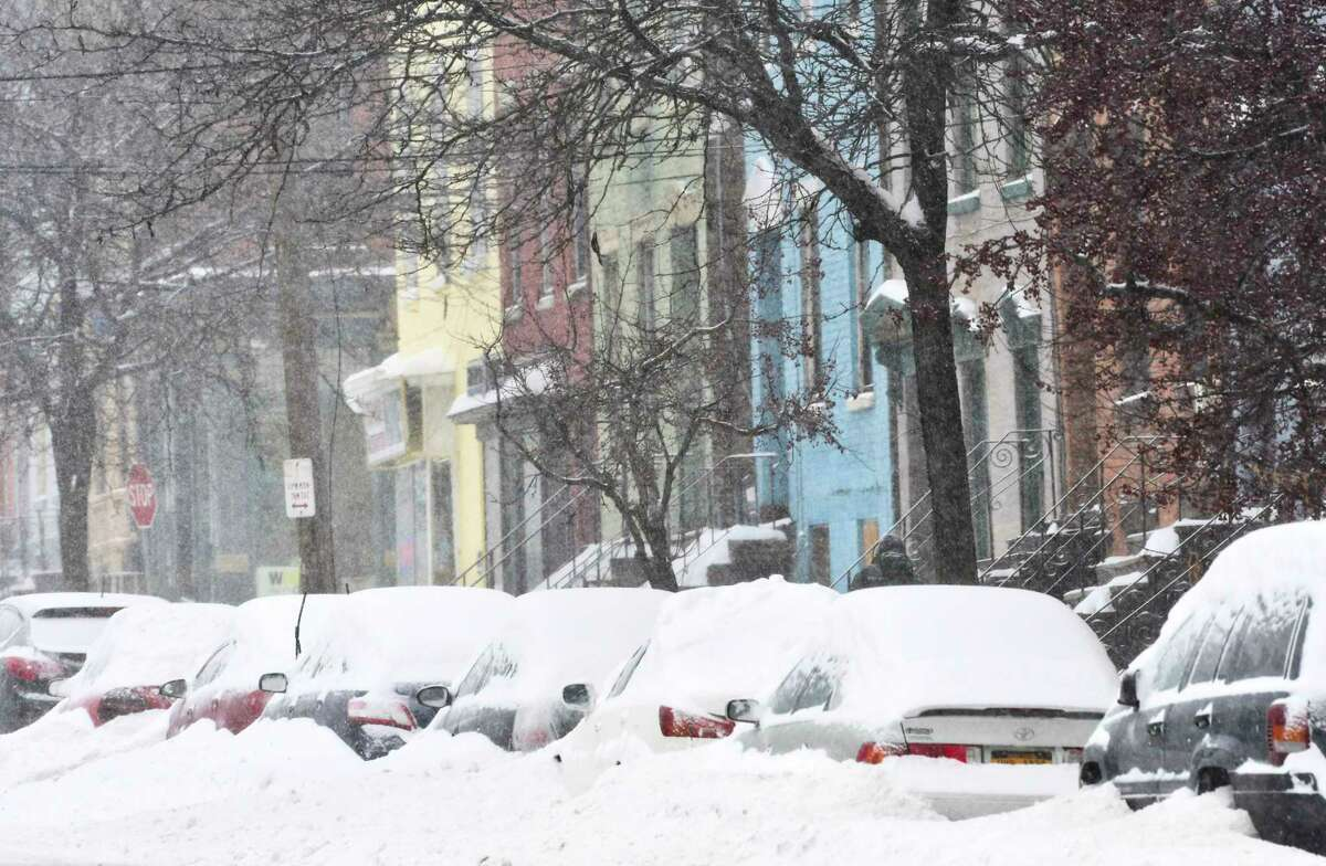 Cars are covered in snow on Sunday, Jan. 20, 2019, in Albany, N.Y. (Paul Buckowski/Times Union)