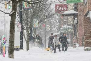 People work to clear snow off of a sidewalk along Lark Street on Sunday, Jan. 20, 2019, in Albany, N.Y.   (Paul Buckowski/Times Union)