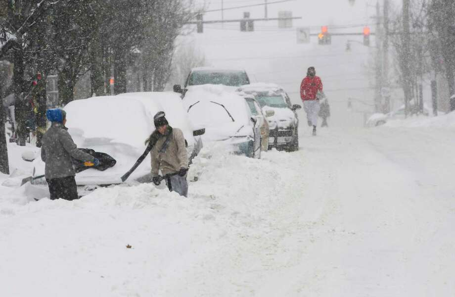 People dig cars out of snow along Lark Street on Sunday, Jan. 20, 2019, in Albany, N.Y.   (Paul Buckowski/Times Union) Photo: Paul Buckowski, Albany Times Union / (Paul Buckowski/Times Union)