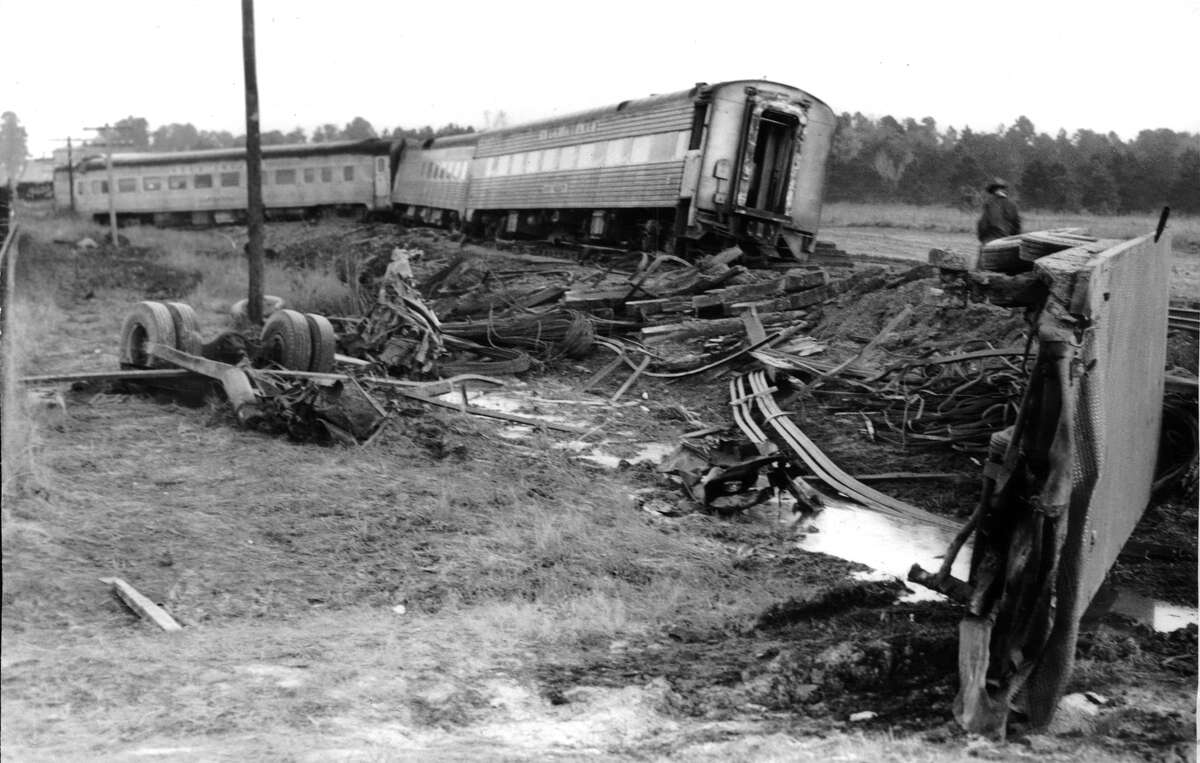 """From the Jan. 17, 1959, Houston Chronicle: A heavily laden truck carrying steel crashed into the locomotive of the Rock Island Railroad's """"Rocket"""" at a North Harris County crossing Friday, killing the truck driver and derailing the passenger train. In the left foreground, to the right of the truck's wheels, is all that is left of the truck cab in which Ray Dawkins (Dawson) of Dallas died. At right foreground is the truck's top. The area is littered with debris. Background, the derailed train coaches."""