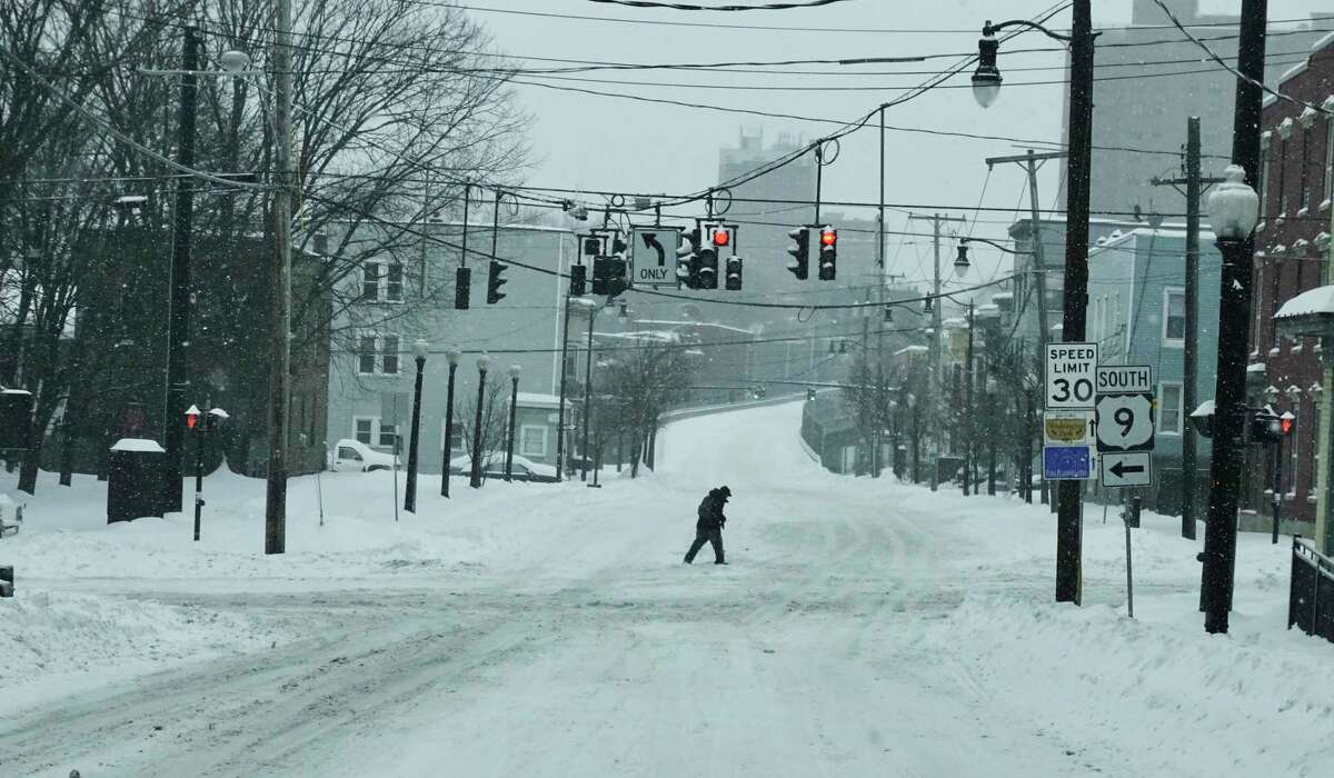 A man makes his way through the snow on Clinton Ave. on Sunday, Jan. 20, 2019, in Albany, N.Y. (Paul Buckowski/Times Union)