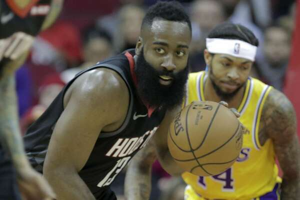 Houston Rockets guard James Harden (13) steals the ball from Los Angeles Lakers forward Brandon Ingram (14) in the first quarter at the Toyota Center on Saturday, Jan. 19, 2019 in Houston.