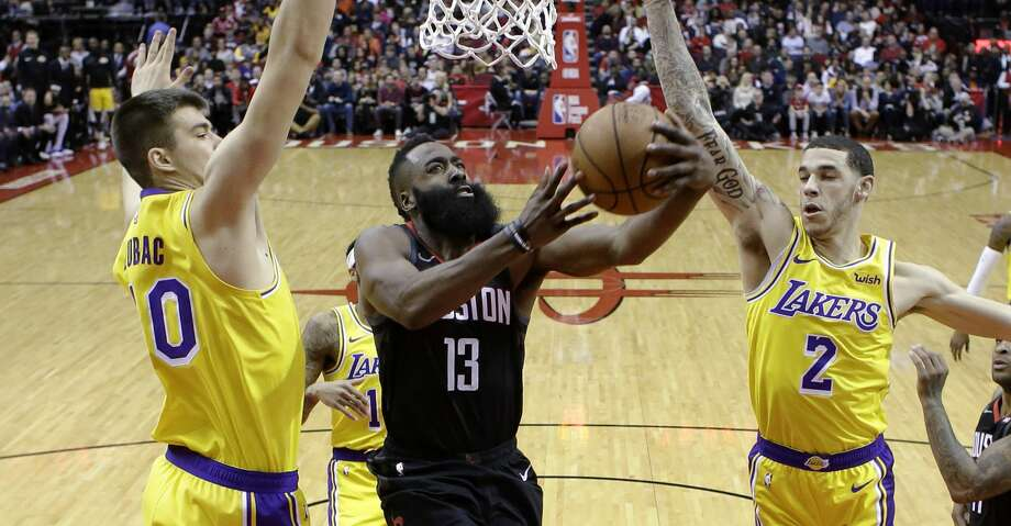PHOTOS: Rockets game-by-game Houston Rockets guard James Harden (13) drives to the basket as Los Angeles Lakers center Ivica Zubac, left, and guard Lonzo Ball defend during the first half of an NBA basketball game Saturday, Jan. 19, 2019, in Houston. (AP Photo/Eric Christian Smith) Browse through the photos to see how the Rockets have fared in each game this season. Photo: Eric Christian Smith/Associated Press