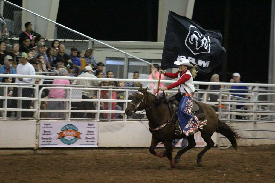 Miss Rodeo Texas, Samantha Cayton, carries the Ram Trucks' sponsor flag at Guadalupe County PRCA rodeo in Seguin four months ago. Cayton will make nightly appearances at the San Antonio Stock Show & Rodeo. Photo: Courtesy Samantha Cayton