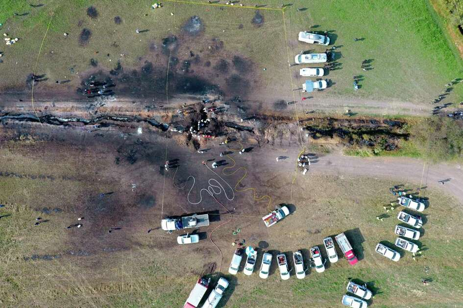 The ground is scorched where an oil pipeline exploded in Tlahuelilpan, Hidalgo state, Mexico, Saturday, Jan. 19, 2019. A massive fireball that engulfed people scooping up fuel spilling from a pipeline ruptured by thieves in central Mexico killed dozens of people and badly burned many more.