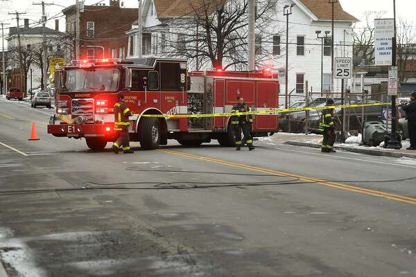 Bridgeport firefighters block off Main Street just south of North Avenue for downed power lines due to high winds in Bridgeport on Sunday. , January 20, 2019.