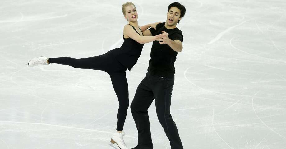 Kaitlyn Weaver and Andrew Poje of Canada practice during the ice dance training session at the Iceberg Skating Palace ahead of the 2014 Winter Olympics, Wednesday, Feb. 5, 2014, in Sochi, Russia. (AP Photo/Darron Cummings) Photo: Darron Cummings/Associated Press