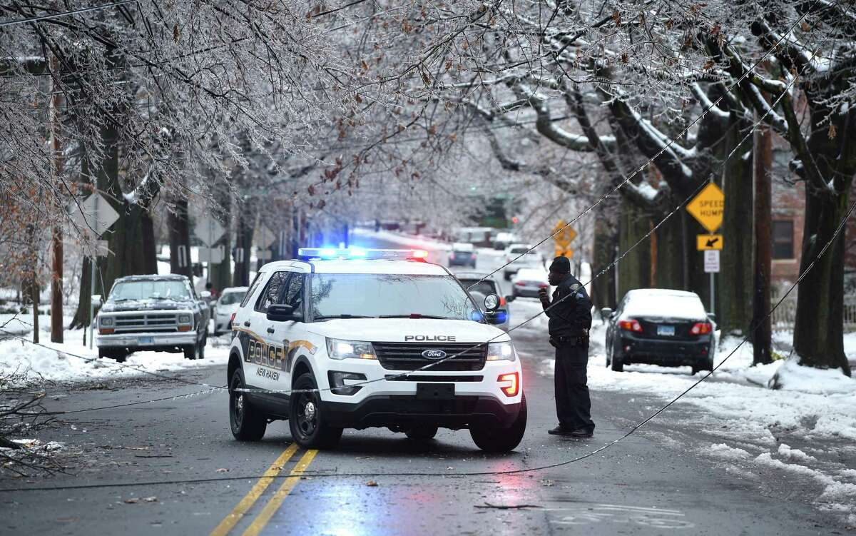 A police car blocks Edwards Street in New Haven where downed utility lines crossed the road on January 20, 2019.