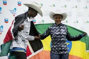 Chevron Houston Marathon winners Albert Korir, left, of Kenya, and Biruktayit, of Ethiopia, pose for photos after speaking to the media on Sunday, Jan. 20, 2019, in Houston.