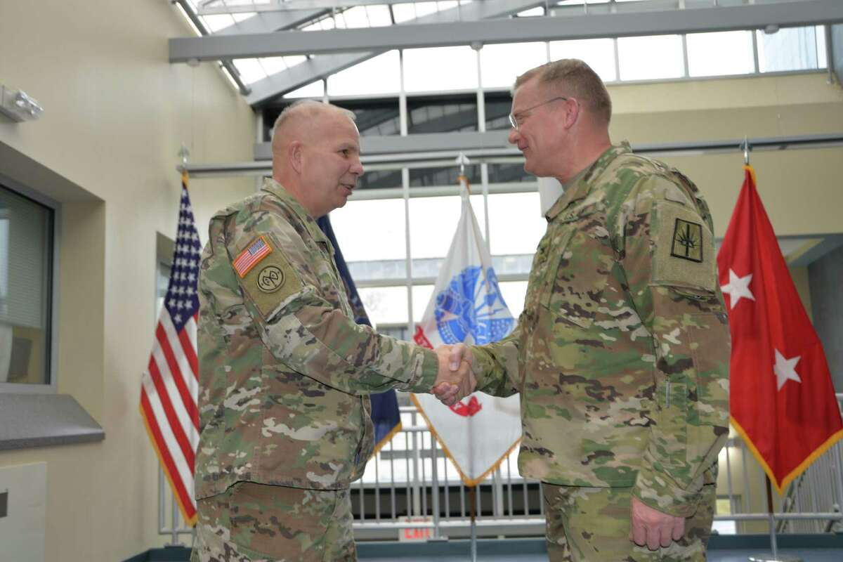 Major General Ray Shields the Adjutant General of the New York National Guard (left) congratulates Col. Robert Epp during his promotion ceremony at the Division of Military and Naval Affairs Headquarters in Latham on Friday, Dec. 21, 2018. Epp is an Iraq veteran and serves full time for the New York Army National Guard. (U.S. Army National Guard photo by Capt. Jean Marie Kratzer)