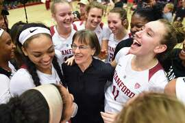 PALO ALTO, CA - JANUARY 20: The Setsuko Ishiyama Director of Womens Basketball Tara Vanderveer, who notched her 900th win at Stanford, celebrates with her players including Stanford Guard Dijonai Carrington (21), left, and Stanford Forward Alanna Smith (11), who scored a career high in points, during the women's basketball game between the Washington State Cougars and the Stanford Cardinal at Maples Pavilion on January 20, 2019 in Palo Alto, CA. (Photo by Cody Glenn/Icon Sportswire via Getty Images)