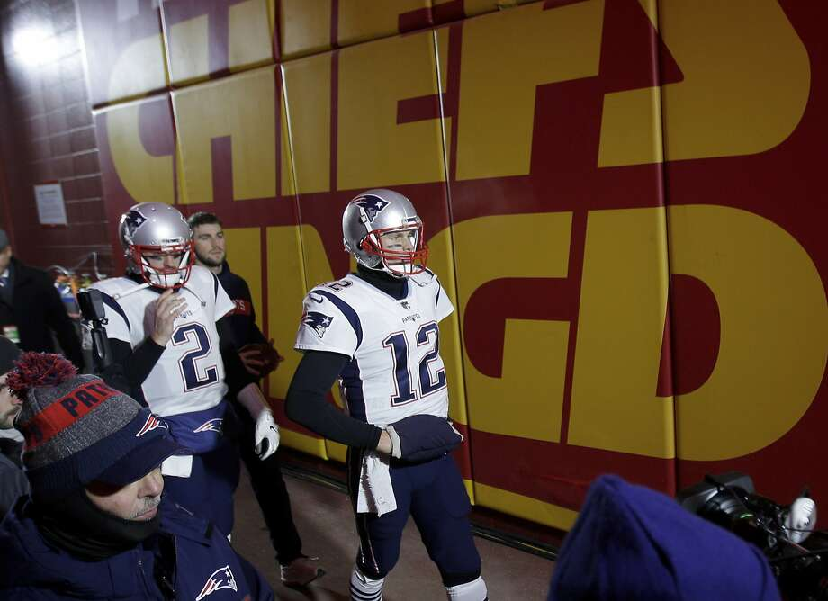 New England Patriots quarterback Tom Brady (12) and Brian Hoyer (2) walks through the tunnel before the AFC Championship NFL football game =against the Kansas City Chiefs, Sunday, Jan. 20, 2019, in Kansas City, Mo. (AP Photo/Charlie Riedel) Photo: Charlie Riedel, Associated Press