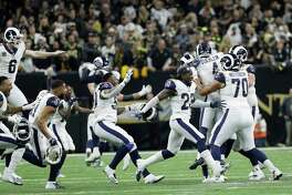 Los Angeles Rams players celebrate after overtime of the NFL football NFC championship game against the New Orleans Saints, Sunday, Jan. 20, 2019, in New Orleans.