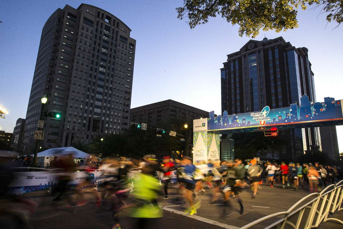 Runners take off from the starting line of the Chevron Houston Marathon on Sunday, Jan. 20, 2019, in Houston.