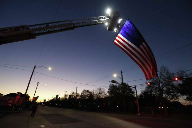The American flag flies over Washington Avenue from Ladder 6 at the fire station during the Chevron Houston Marathon, Sunday, January 20, 2019, in Houston.