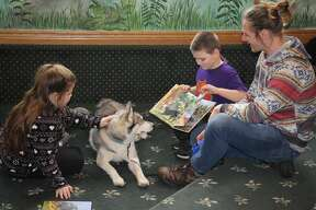 Children got the opportunity Saturday to read to a friendly Siberian Husky named Akuna at the Bad Axe Library.