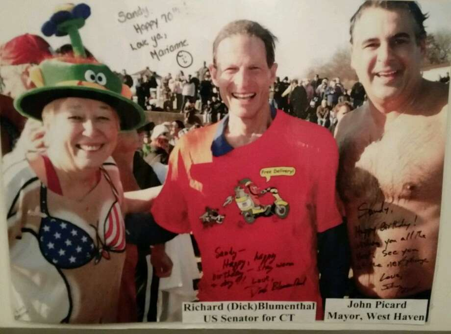 New Haven resident Sandy Kline, 78, is a veteran of West Haven's Icy Plunge and has a poster sized copy of this photo with she, U.S. Sen. Richard Blumenthal, D-Conn., and former Mayor John Picard at a past year's event. A friend had the photo enlarged. Photo: Photo Provided By Sandy Kline / Photo Provided By Sandy Kline