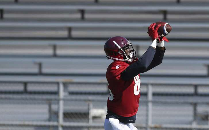 Jevoni Robinson, catching a pass during a San Antonio Commanders' practice, is making the switch from college and pro basketball to pro football. After playing pro basketball in Italy, he was with the Houston Texans during training camp in 2018.