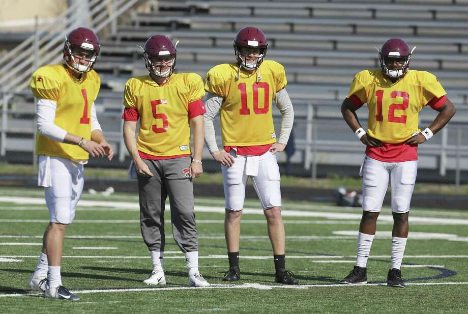 Quarterbacks Dalton Sturm (from left), Logan Woodside, Dustin Vaughan and Marquise Williams are seen at the San Antonio Commanders practice on Thursday, Jan. 17, 2019. The team kicks off their debut season on February 9 with their first home game the Alamodome against the San Diego Fleet. (Kin Man Hui/San Antonio Express-News) Photo: Kin Man Hui /San Antonio Express-News / ©2019 San Antonio Express-News