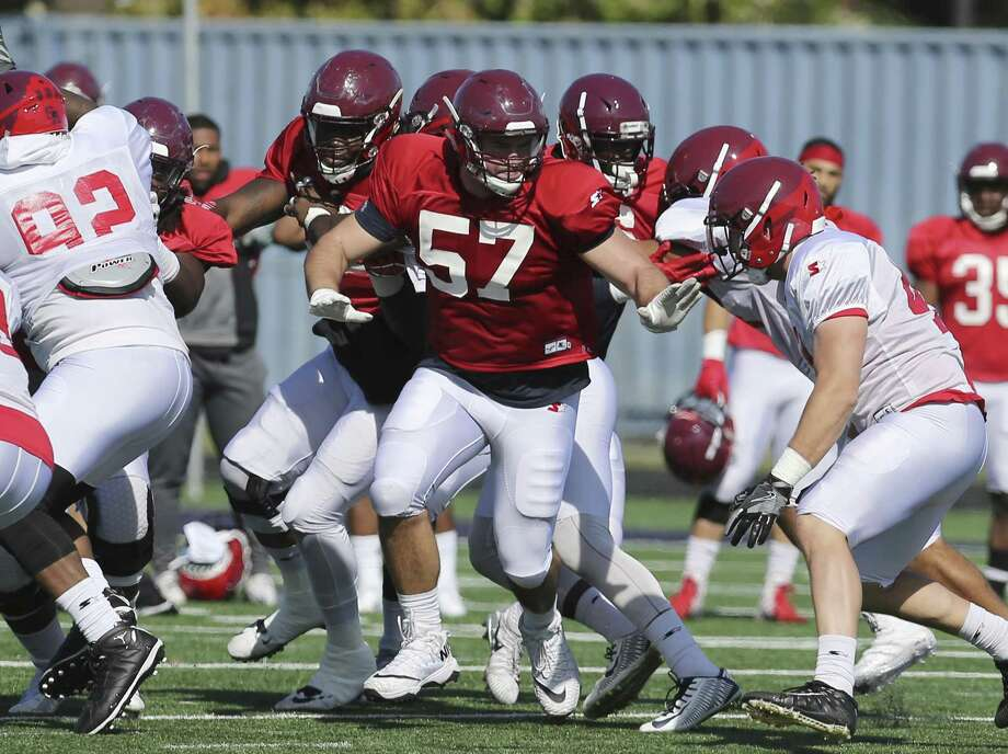 Guard Mason Gentry (57) takes part in a play at the San Antonio Commanders practice on Thursday, Jan. 17, 2019. The team kicks off their debut season on February 9 with their first home game the Alamodome against the San Diego Fleet. (Kin Man Hui/San Antonio Express-News) Photo: Kin Man Hui, Staff Photographer / San Antonio Express-News / ©2019 San Antonio Express-News