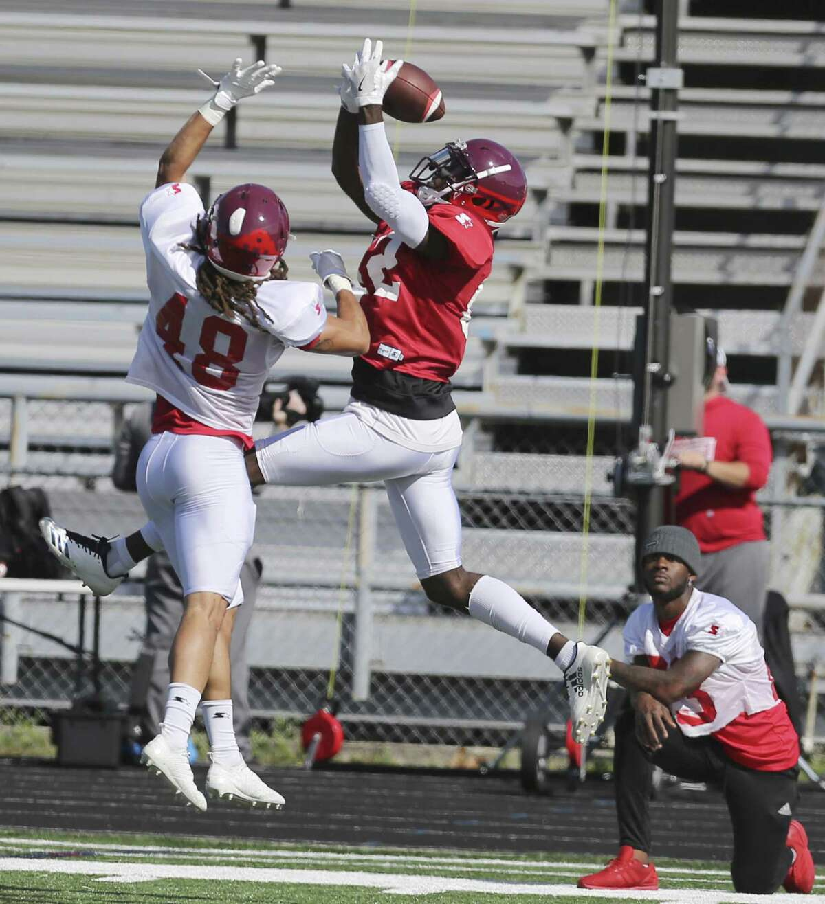 Receiver Mekale McKay makes a leaping grab over cornerback Oscar White in a recent Commanders practice. The team will play 10 games in its inaugural season.