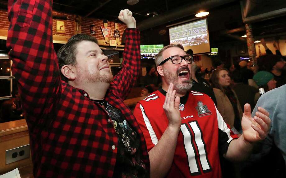 Atlanta Falcons fans Jonathan Springston, left, and Albert Hopkins react as the Los Angeles Rams beat the New Orleans Saints, 26-23, in overtime to win the the NFL football NFC championship game, while watching at Midway Pub in Atlanta on Sunday, Jan. 20, 2019. Falcons fans were dreading their rivals the Saints advancing to the Super Bowl in Atlanta. (Curtis Compton/Atlanta Journal-Constitution via AP) Photo: Curtis Compton, AP / Atlanta Journal-Constitution