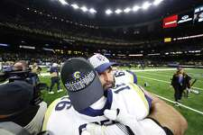 John Sullivan (65) and Jared Goff (16) of the Los Angeles Rams celebrate after defeating the New Orleans Saints in the NFC Championship game at the Mercedes-Benz Superdome Sunday.