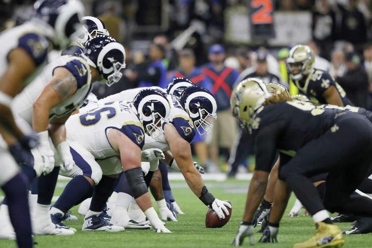 Rams center John Sullivan prepares to snap a ball against the New Orleans Saints during the NFC Championship game at the Mercedes-Benz Superdome on Janu. 20 in New Orleans. Sullivan, a Greenwich High School grad, will play in his first Super Bowl on Sunday against the Patriots.