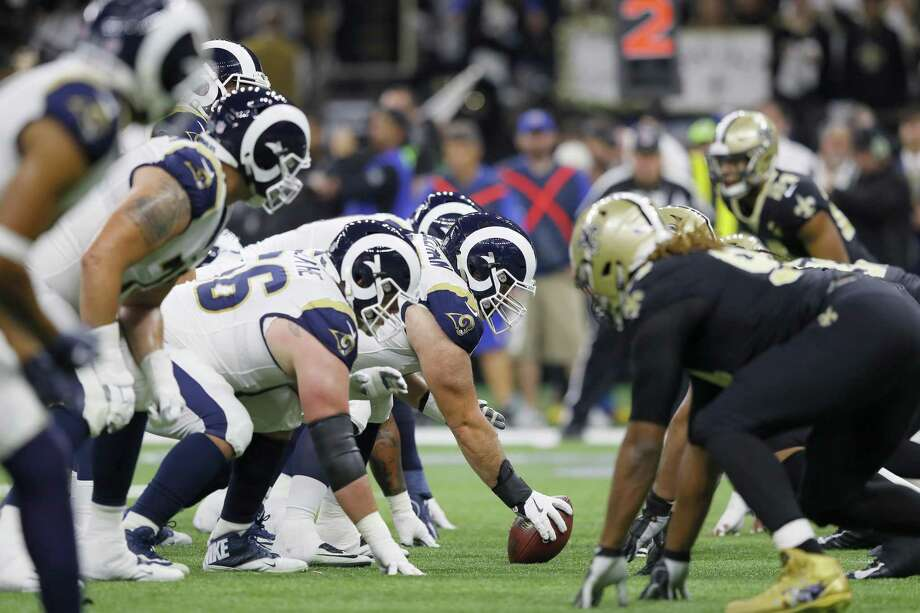 Rams center John Sullivan prepares to snap a ball against the New Orleans Saints during the NFC Championship game at the Mercedes-Benz Superdome on Janu. 20 in New Orleans. Sullivan, a Greenwich High School grad, will play in his first Super Bowl on Sunday against the Patriots. Photo: Kevin C. Cox / Getty Images / 2019 Getty Images